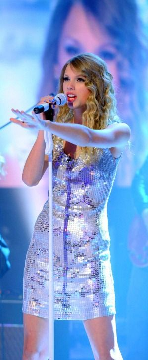 Love her sparkly dress.  (: