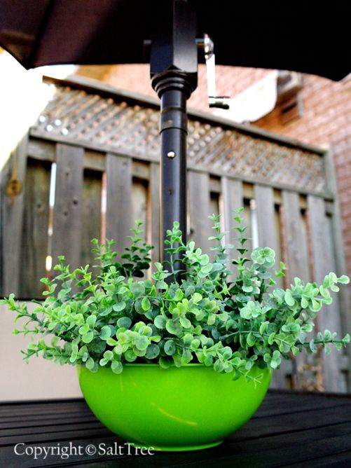 """DIY Dollar Store Planter for Umbrella Patio Tables.  Love this idea.  Kinda gives me one of those """"oh DUH! moments it is so simple."""