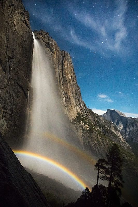 A moonbow arches over Upper Yosemite Falls. Photo by Grant Ordelheide