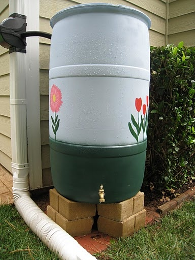 25 best ideas about rain barrel stand on pinterest for Rain barrel stand ideas
