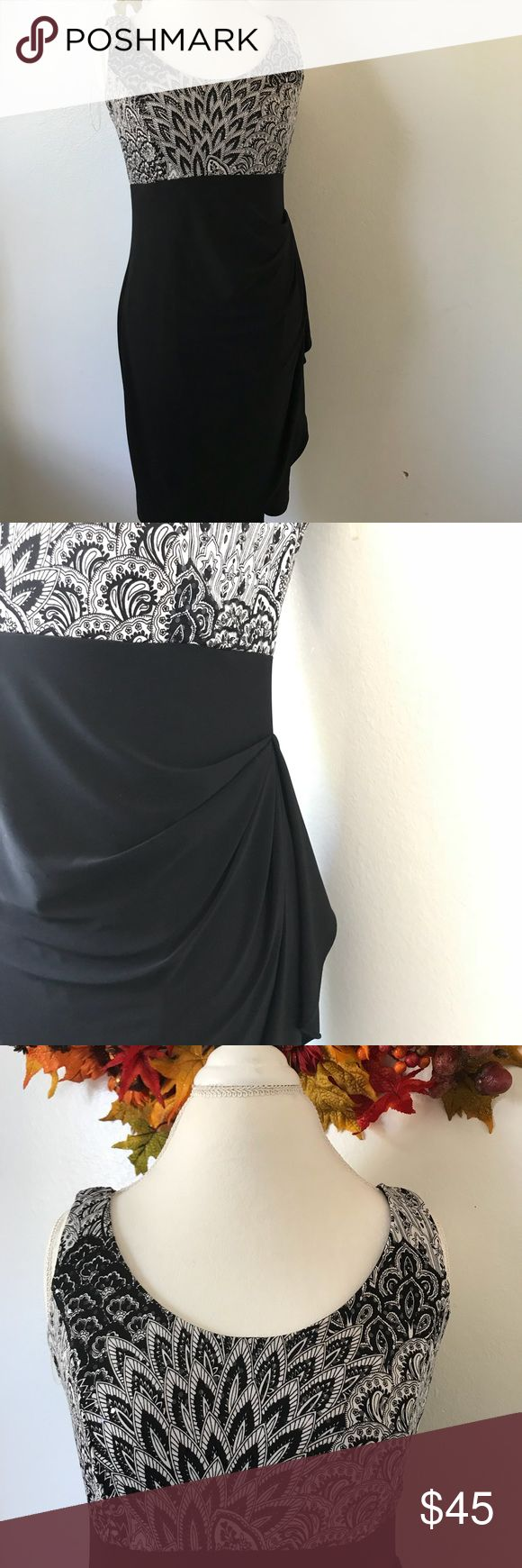 Dress Barn Black and white Sequin Dress w/ Jacket Has paisley designs . Comes with a jacket . Worn once! Jacket was never worn. Still has tag attached on that piece . Armpit to armpit 17'. Shoulder to hem 38'. Has a great design on dress . Dress Barn Dresses Midi
