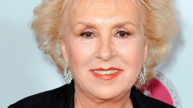 Doris Roberts, 90 years old, died  peacefully in her sleep, Sunday, April 17, 2016, per her son, Michael Cannata.  Known for her role as the loving but meddling mom on Everybody Loves Raymond.    Her celebrated career spanned six decades, and she won four Emmys for her portrayal of Marie Barone.