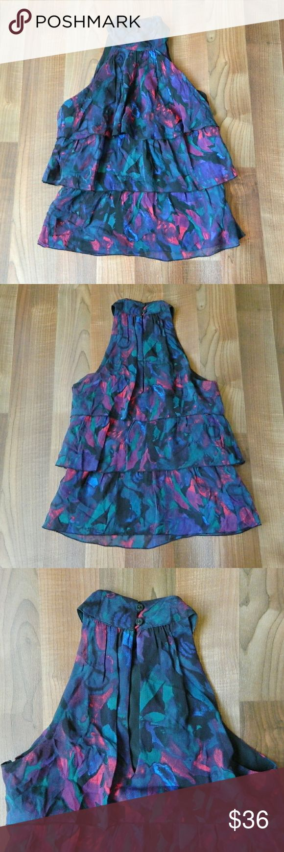 Armani Exchange Ruffle High Neck Sleeveless Top Silk blouse in great pre-owned condition by Armani Exchange. Size XS. Made of 100% silk. Fully lined interior. High neck with two button closure and side hidden zipper. Would look great with skinny jeans! No trades, Open to offers. Armani Exchange Tops Blouses