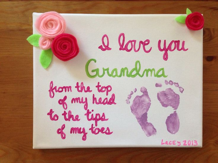 Baby Footprint Gift for grandma- Hand made felt flowers and acrylic paint on a canvas.
