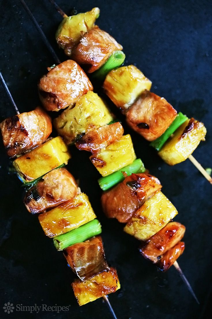 Salmon Teriyaki Skewers with Pineapple! Fresh salmon, marinated in teriyaki sauce and grilled on skewers with pineapple and green onions. Easy! On SimplyRecipes.com