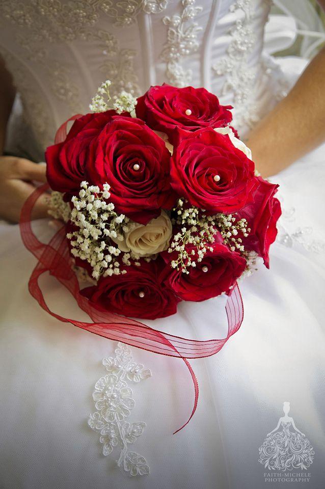 Red rose classic bridal bouquet.  Silver and red themed wedding at Heisler Park Gazebo, Laguna Beach, California.  http://faith-michele.com/tera-danny-at-heisler-park-laguna-beach-wedding-photographer/