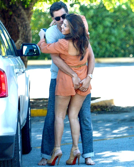 Kourtney Kardashian and Scott Disick put on a major public display of affection while receiving a new Ferrari in Miami on October 29, 2012.