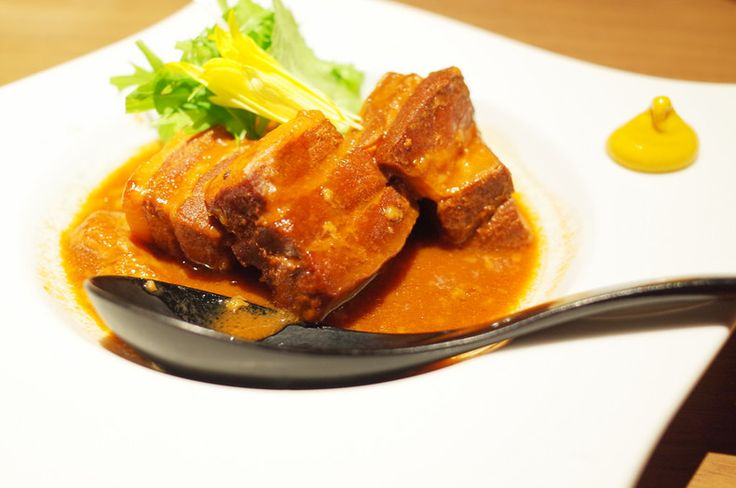 Kakuni Kakuni is thick cut pork belly simmered in dashi, soy sauce, mirin, sugar and sake. A specialty of Nagasaki but popular throughout Japan. Served with Karashi hot mustard on the side.
