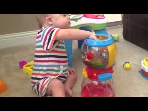 Baby With Down Syndrome Playing With Developmental Toy (Would be great to have one of these)