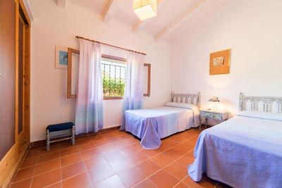 Villa Verd is a beautiful country house, finished with stone in the Majorcan style, located in a quiet area surrounded by holm oak and pine woods and around the finca, orange trees.   The house is a bungalow; it has 3 bedrooms and 2 bathrooms (1 en suite), a large well equipped kitchen, living - dining room with two sofas, wood burning stove and satellite TV. The decoration is modern and bright with some traditional Mallorcan touches.  Outside, the large covered terrace is a perfect spot to…