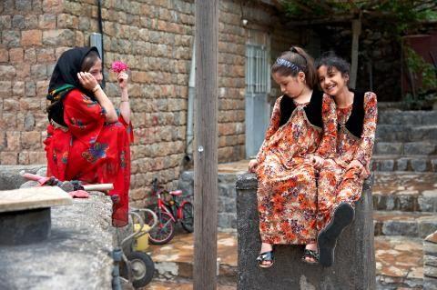 Kurdish Girls in traditional Dresses in the Village Hajij in the famous Zagros Range.