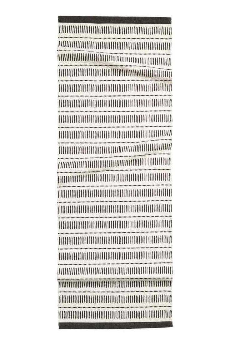 Mintás pamutszőnyeg: Négyszögletű, nyomott mintás pamutszövet szőnyeg.