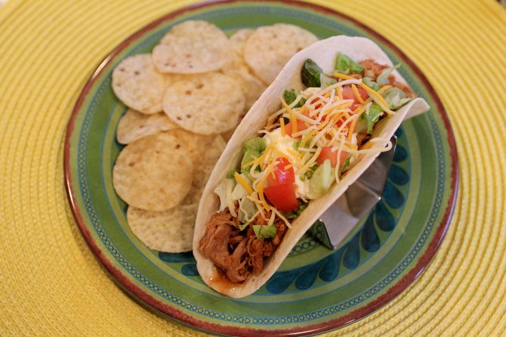 Slow Cooker Pulled Pork Tacos - one serving has only about 200 calories plus it's DELICIOUS!  Just throw the pork in the crock pot before work and then enjoy amazing tacos when you get home!