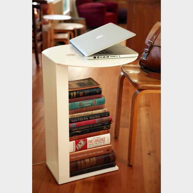 {The Lovejoy side table} awesome design! has a built in grommet hole for cables, even.