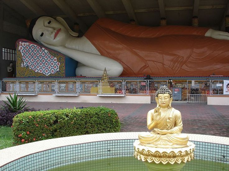 Reclining Buddha in a Thai Buddhist temple in Kelantan//Reclining Buddha in Wat Photivihan//Southeast Asia's largest reclining Buddha, in a Thai Buddhist temple in Kelantan//Kelantan is a state of Malaysia. The capital and royal seat is Kota Bharu