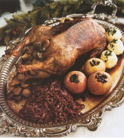 Roast goose with rum raisin stuffed apples and red kraut. Christmas f.are dating back to medieval times