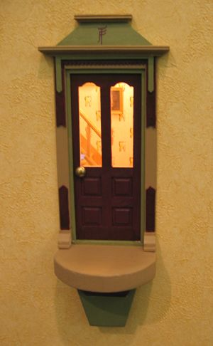 Fairy Door: a tooth fairy door at a dentist's office. Follow link for photos of setting and interior shots of tooth fairy details.