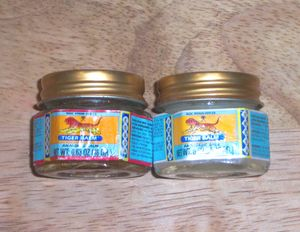 Version of tiger balm. I swear by Tiger Balm for headaches & colds. For headaches, I just rub a little into my temples