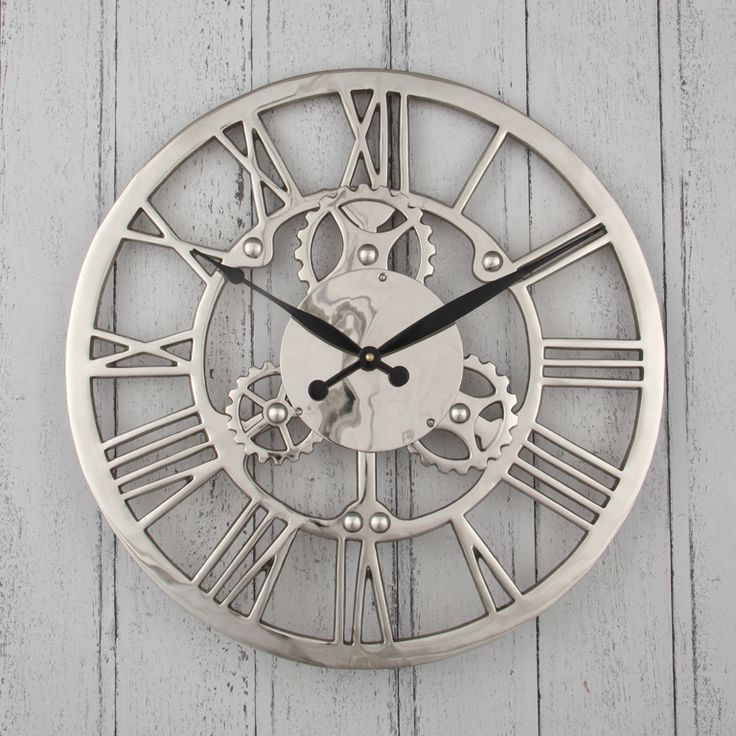 Silver Cog Skeleton Wall Clock A bold clock in a skeleton style with cog detail and Roman Numerals