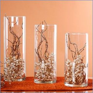 These lovely glass vases filled with pearls and branches make inexpensive centerpieces.