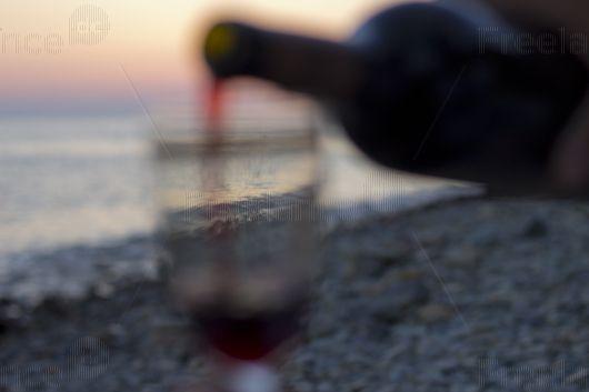Looking through the glass of wine. #sunset #glass #wine #wave #romance #freelancer #freelancecreative #freelancediscount