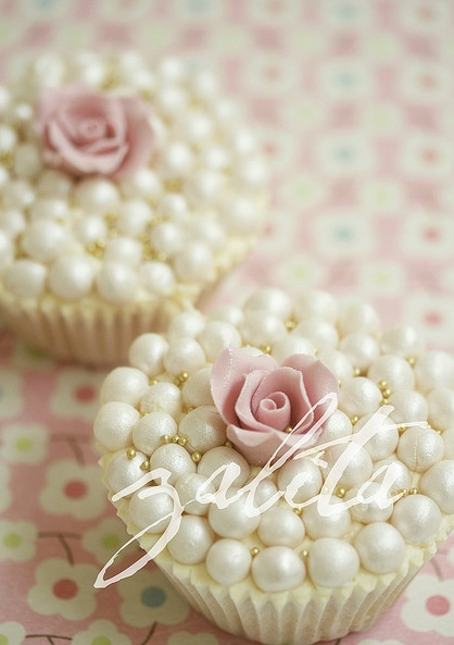 Do a few cupcakes like this. walmart has these pearls in white (big) and in pink (small)