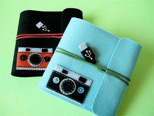 CD cases with camera applique and faux USB closure | by hine