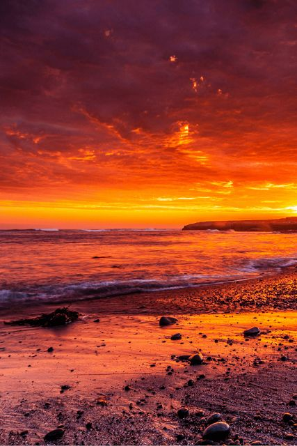 Mexico - beach at Sunset, yellow orange purple clouds and sky