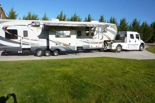 2011 heartland rv cyclone model 3950 about 42 feet long a triple axel toy hauler with 6 each - Garage for rv model ...