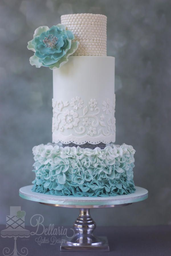 Ombre petal ruffles, pearls, lace and flower - stunning wedding cake design.