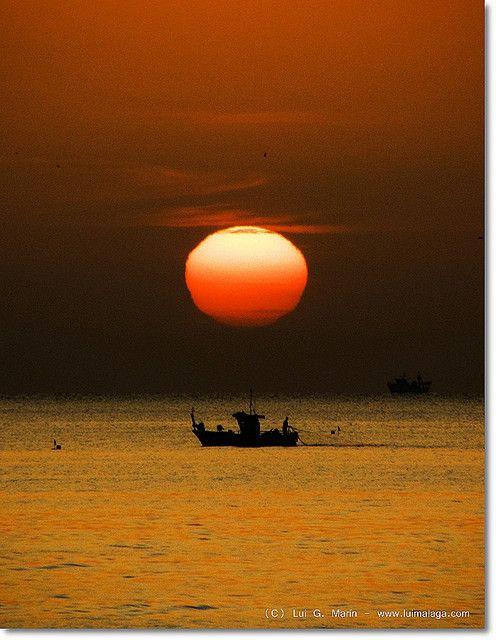 Pescando al amanecer - Fishing at dawn.This morning in Torremolinos (Spain)
