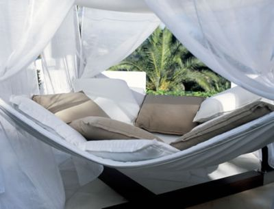 I want one! This Cocoon hammock is a luxury outdoor retreat waiting on your own porch.