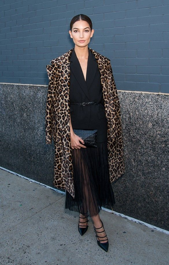 Lily Aldridge wears a black belted midi dress with a leopard coat and strappy black pointed-toe heels