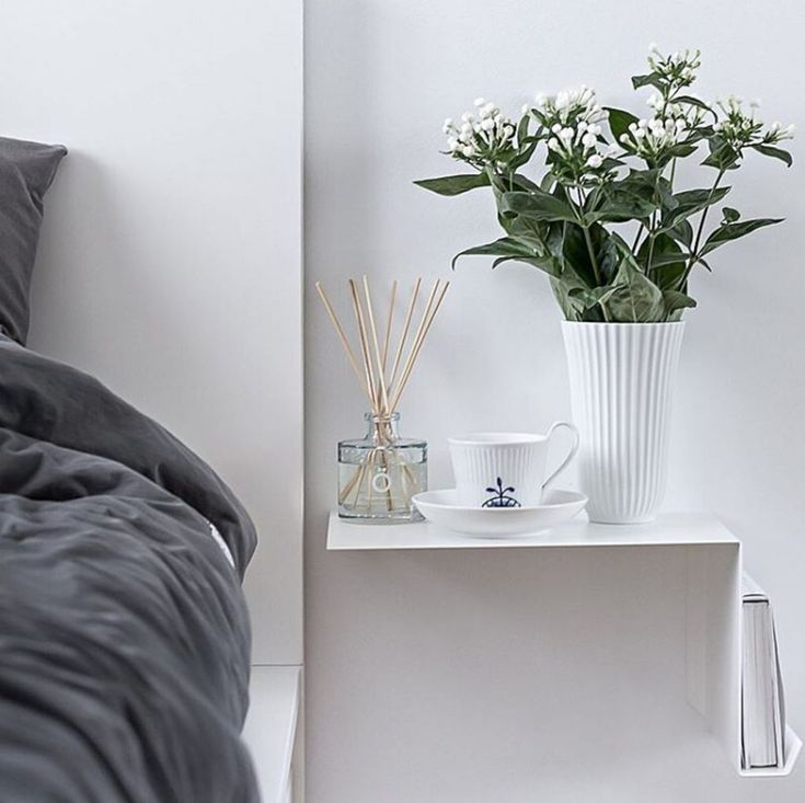 A floating nightstand is a great space-saving solution.