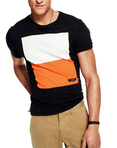 A Big, Bold Graphic T-shirts call for simple graphics, not intricate ones. This is your chance to get all Rothko. Note the shorter sleeves and how the tee hits just barely below the waist. That's how a good tee fits. When you get a new tee, yank on the collar a bit. You don't want it choked around your neck. Saturdays NYC $40