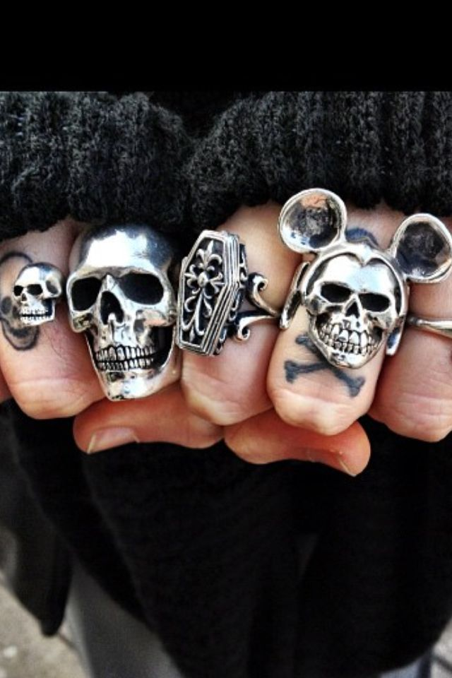 that's my kinda rings. skull, coffin, cross bones, tattoos, finger tats
