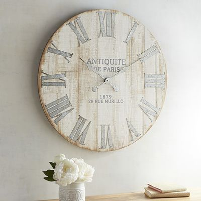 An antique-style clock that doesn't cost a fortune in cash and time spent treasure hunting? You better believe it. Our exclusive, oversized clock is crafted with rustic fir, then whitewashed and finished with galvanized iron hands—a treasured find if we say so ourselves.