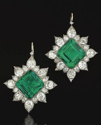 A pair of emerald and diamond earrings, circa 1880. Each of stylised star design collet-set to the centre with a square step-cut emerald within a border of old mine and rose-cut diamonds.