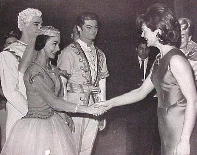 U.S. first lady Jacqueline Kennedy thanks Dame Margot Fonteyn, prima ballerina of Britain's Royal Ballet, for appearing with the American Ballet Theater in Washington, D.C., on Dec. 12, 1962. Viktor Rona, center, of the Budapest State Opera, Bruce Marks of the American Ballet, partly hidden at left, also make an appearance for the performance.