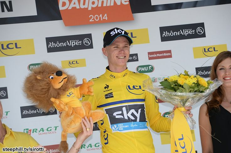 2014 criterium-du-dauphine photos stage-01 - Dress rehearsal for July? Christopher Froome (Team Sky) in Yellow holding the Crédit Lyonnais Lion in Lyon