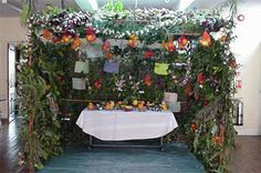 sukkot-inside.  A Jewish celebration that is celebrated at harvest time.  The Sukkot is usually a decorated covering over a table where a family will eat for a week during the celebration of the holy days.