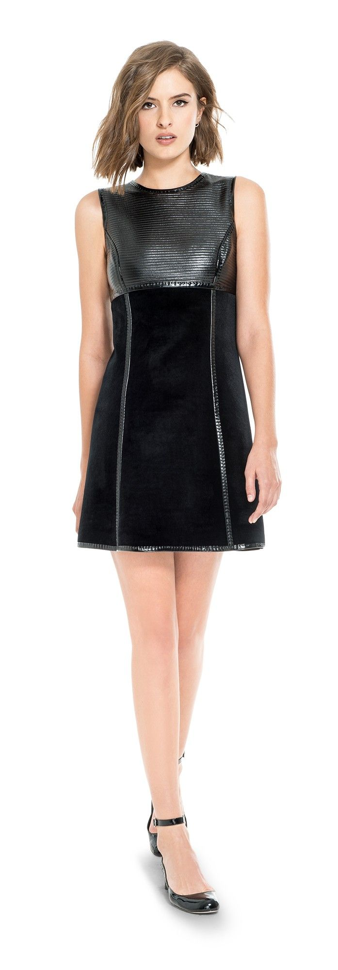 Both mod and modern, this sleeveless shift dress is an amazing find. Fashioned from plush velvet bonded to soft jersey with a ribbed patent bodice and detailed with glossy patent seams and scuba-style zipper pull, its vibe is elegant, luxe and impossibly cool. The versatile and flattering silhouette works from day into night and smartly layers over fitted long sleeved tops and under the coordinating jacket. Leon Max Collection.