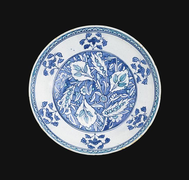 AN IZNIK BLUE AND WHITE POTTERY BOWL, TURKEY, CIRCA 1540