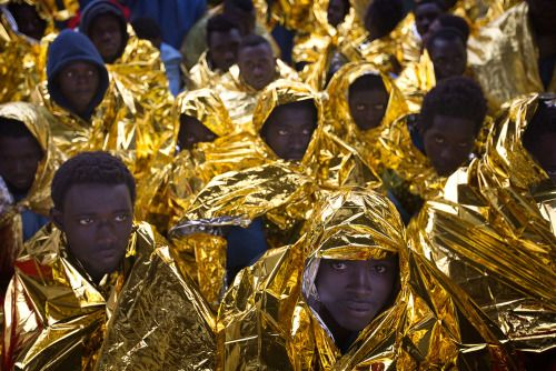 Photos of the day  January 29 2017Wrapped in blankets...  Photos of the day  January 29 2017  Wrapped in blankets Sub-Saharan migrants sit on the deck of the Golfo Azzurro rescue vessel after arriving at the port of Messina Italy with more than 299 migrants aboard the ship rescued by members of Proactive Open Arms NGO; Seattle police push the last group of protesters out of a Seattle-Tacoma International Airport terminal after giving a final dispersal order; Switzerlands Roger Federer…