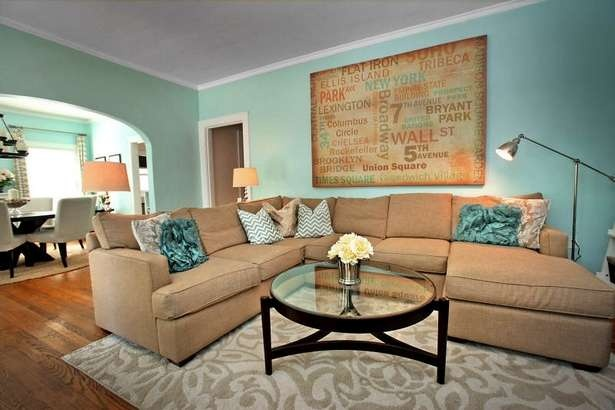 Teal and tan living room. Looks comfortable and modern!