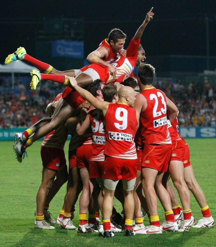Gold Coast Suns celebrate footy win