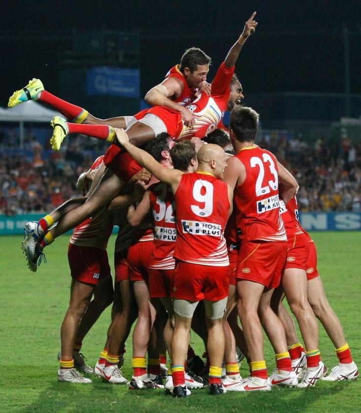 Gold Coast Suns celebrate footy win