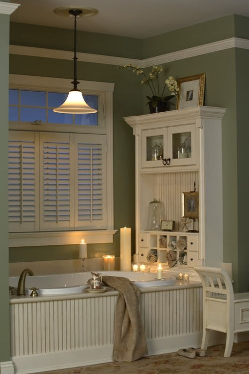 """love the """"hutch"""" at end of tub. great use of a big wall vs. the typical towel bar and pics. And beadboard along the tub..."""
