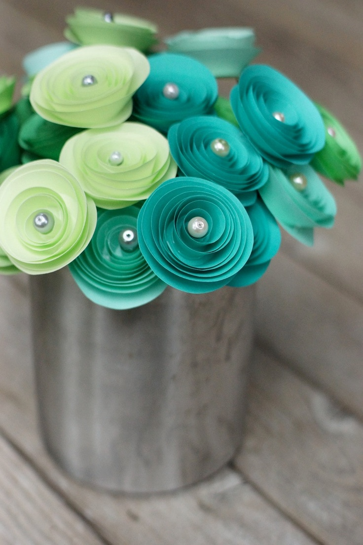 paper rosettes with a pearl and a sequin, wonder if I can recycle paper and spray paint the color I want?