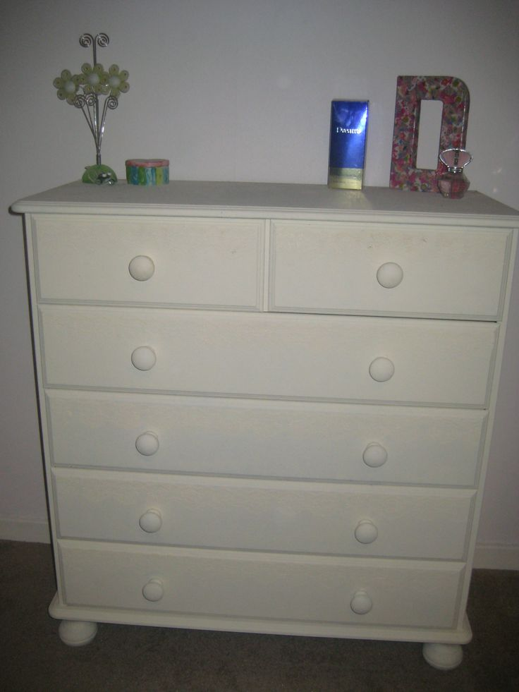 Updated chest of drawers with cream paint and then stuck on  lace and painted over to create this look.